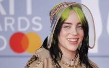 US singer-songwriter Billie Eilish poses on the red carpet on arrival for the BRIT Awards 2020 in London on 18 February 2020. Picture: AFP