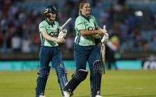 Oval Invincibles' Mady Villiers (L) and Oval Invincibles' Dane van Niekerk celebrate victory during the inaugural match of the new cricket format, The Hundred played between the Oval Invincibles and the Manchester Originals women's cricket teams at The Oval in south London on 21 July 2021. Picture: Ian Kington/AFP