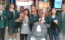 From Left: Timothy Schlesinger, Ralph McDougall, Mpho Nkwana, Dylan Nelson (Deputy Leader), Hannah Clayton,SangEun Lee,Liam Baker (Team Leader)Front- Rauseenah Upadhey with the SA Maths Foundation mascot.Picture: Supplied
