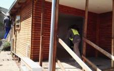 City of Johannesburg workers removing an illegal wood structure in Northcliff. Picture: @CityofJoburgZA/Twitter