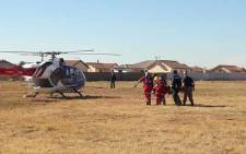 ER24 paramedics carry a patient to a waiting helicopter. Picture: ER24