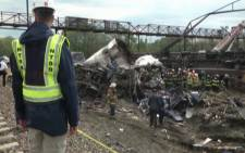 Investigators search through the rubble of an Amtrak train crash that killed 8 people in the US. Picture: Supplied.