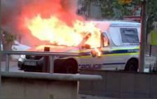 A police van was set alight in Braamfontein. Picture: @_ArriveAlive.