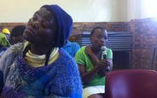 FILE: A community leader says a pregnant woman was allegedly kicked by a police officer during the forced removals. Picture: Siyabonga/EWN.