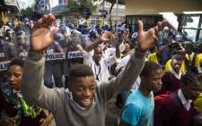 Cosas members protest against a police line pushes against on Longmarket Street during Sona2017. Picture: Thomas Holder/EWN