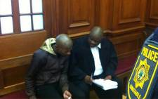 Anni Dewani's alleged killer Xolile Mngeni and his lawyer Matthews Dayimani in court on 17 September 2012. Picture: Graeme Raubenheimer/EWN