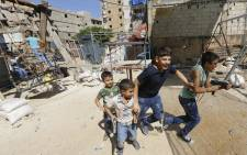 Palestinian and Syrian children play on a street in the Shatila Palestinian refugee camp, on the southern outskirts of the Lebanese capital Beirut, in 2016. Picture: AFP.