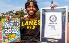 Zion Clark has officially set the Guinness World Record for the fastest 20-meter walk on two hands. Picture: big_z_2020/Instagram.