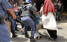 Police forcefully removed protesting foreign nationals in the Cape Town CBD on 30 October 2019. Picture: Kaylynn Palm/EWN.
