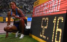 USA's Dalilah Muhammad celebrates after winning the Women's 400m Hurdles final in a new world record time at the 2019 IAAF Athletics World Championships at the Khalifa International Stadium in Doha on 4 October 2019. Picture: AFP