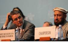 First deputy Chief Executive of the Islamic State of Afghanistan, Mohammad Khan (R) and World Trade Organisation (WTO) Director-General Roberto Azevedo. Picture: AFP