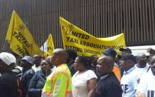 Hundreds of taxi operators make their way to the office of the MEC in the Johannesburg CBD on 17 November 2014. Picture: Aurelie Kalenga/EWN.