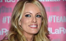Adult film star Stormy Daniels poses and signs autographs at Chi Chi Larue's adult entertainment store in West Hollywood, California, in May 2018. Picture: AFP.