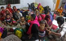 Bangladeshi villagers take refuge in a cyclone shelter following an evacuation by authorities in the coastal villages of the Cox's Bazar district on 29 May, 2017 as Cyclone 'Mora' gradually approaches the coastline. Picture: AFP
