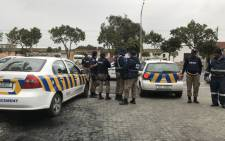 FILE: City of Cape Town law enforcement officials monitor protesters in Gugulethu on 12 July 2018. Picture: Lauren Isaacs/EWN