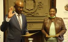 Former Cooperative Government and Traditional Affairs Deputy Minister Parks Tau being sworn in as the new Gauteng economic development MEC on Wednesday, 9 December 2020. Picture: Supplied