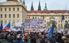 Protester holds sign reading in czech 'Stop Islam and stop Merkel', during an anti-Islam rally in front of the Prague Castle in Prague, Czech Republic, 06 February 2016. Picture: EPA/FILIP SINGER the Prague Castle.