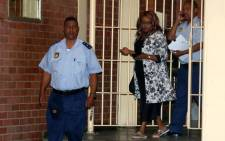 Convicted drug dealer Sheryl Cwele is led by policemen from the holding cells at the Pietermaritzburg High Court on Thursday, 4 October 2012. Cwele will start a 20-year prison term at the Westville Prison in Durban.She is the former wife of State Security Minister Siyabonga Cwele. Picture: Shan Pillay/SAPA