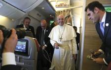 Pope Francis arrives to speak to reporters aboard a plane on the way to Abu Dhabi on 3 February 2019. Pope Francis heads to the UAE on 3 February for the first-ever papal visit to the Arabian Peninsula, birthplace of Islam, where he will hold an open-air mass for tens of thousands of Catholics. Picture: AFP