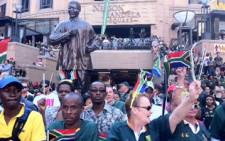Bok fans show their support on Springbok Day at Nelson Mandela Square in Sandton. Picture: Taurai Maduna/EWN