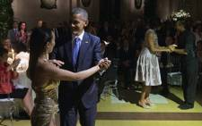 US President Barack Obama and First Lady Michelle Obama (2nd R) dance the tango with dancers during a state dinner at the Kirchner Cultural Centre in Buenos Aires on 23 March, 2016. Picture: AFP.