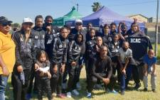 Riyaad Avontuur (front row, third from right) has survived trauma and years of substance abuse and now works to make a change in his community. Picture: Supplied