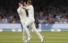 England's Stuart Broad (R) celebrates with teammates after taking the wicket of Ireland's Andy Balbirnie for five on the third day of the first cricket Test match between England and Ireland at Lord's cricket ground in London on 26 July 2019. Picture: AFP