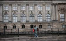 A women passes by the Bode museum, part of the Museum Island, in Berlin on 21 October 2020. According to media reports, dozens of works of art were damaged by unknown persons on Berlin's Museum Island on the Unification Day. Picture: AFP