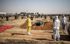 FILE: Undertakers from the Avbob funeral house arrive at the Doornkop cemetery in Soweto, South Africa, on 21 July 2020 for a funeral. Picture: MARCO LONGARI/AFP