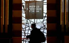 The silhouette of a participant is seen as he enters the Congress Center during the World Economic Forum annual meeting on 23 January, 2015 in Davos. Picture: AFP.