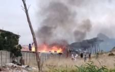 Conflict among warring gangs in Ocean View on 26 December 2020 led to the death of a man, another wounded, vehicles torched, and a home damaged. Picture: Supplied.
