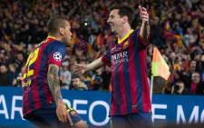 Barcelona's Lionel Messi and Dani Alves celebrate together after Messi's goal during the Champions League match against Manchester City on 12 March 2014. Picture: Facebook.