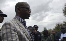 Deputy Police Minister Bongani Mkongi visiting the site where the body of missing Oyingcwele Zokufa was found. Picture: Lauren Isaacs/EWN.