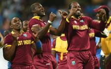 FILE: West Indiess captain Darren Sammy Dwayne Bravo and Chris Gayle celebrate after victory in the World T20 cricket tournament second semi-final match between India and West Indies at The Wankhede Stadium in Mumbai on 31 March, 2016. Picture: AFP