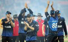 New Zealands Kane Williamson (C) and teammates celebrate as they leave the field after the Quarter Final Cricket World Cup match between New Zealand and the West Indies played at the Wellington Regional Stadium in Wellington on 21 March, 2015. Picture: AFP