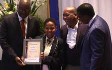 A top performing matric pupil collects her award at a ceremony hosted by the Gauteng Department of Education, Tuesday 6 January 2014. Picture: Vumani Mkhize/EWN.