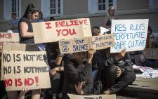 UCT students hold up posters during a protest against rape and sexual abuse on campus on 11 May 2016. Picture: Thomas Holder/EWN
