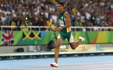 South Africa's Wayde van Niekerk competes in the Men's 400m Final during the athletics event at the Rio 2016 Olympic Games at the Olympic Stadium in Rio de Janeiro on 14 August, 2016. Picture: AFP.