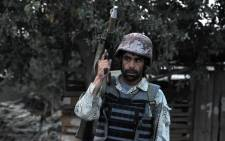 FILE: An Afghan soldier holds a rocket propelled grenade launcher following an attack by Taliban militants on the Afghan intelligence service office in Jalalabad on 30 August, 2014. Picture: AFP.