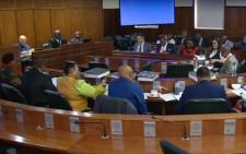A screengrab of MPs presiding over a parliamentary inquiry into the naturalisation of members of the Gupta family.