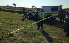 Police cordon off the scene where Olivia van Voeght's body was found in a vlei in Lotus River on 1 August 2013. Picture: Lauren Isaacs/EWN