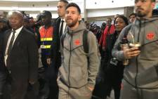 Barcelona's stars Lionel Messi (centre) and Luis Suarez (right) arrive at Johannesburg's OR Tambo International Airport on 16 May 2018 for the friendly match against Mamelodi Sundowns. Picture: @Masandawana/Twitter