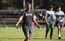 Team coach Neil Powell gives instructions as members of the South Africa Rugby 7s team (the Blitzbokke) take part in a practice session in Stellenbosch on May 13, 2021. This session is part of the team's build-up for the upcoming Tokyo olympics for which they have qualified. Picture: Rodger Bosch / AFP