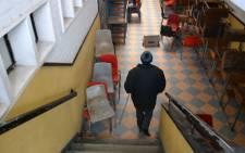 James May, a Hanover Park High school guard patrols the empty halls. Picture: Aletta Gardner/EWN