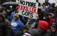 Demonstrators protest the shooting of Laquan McDonald along the Magnificent Mile 27 November, 2015 in Chicago, Illinois. Picture: AFP.