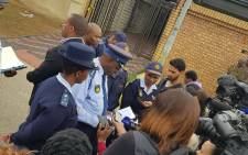Police officers outside a drug laboratory in Orlando Soweto on Thursday 12 April 2018. Picture: Twitter/@SAPoliceService