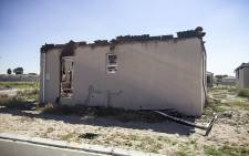FILE: Land invaders were arrested and charged with public violence and destruction of private property when they invaded a housing estate in Kalkfontein near Kuilsriver in Cape Town on 12 April 2015. Picture: Thomas Holder/EWN