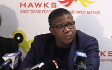 Police Minister Fikile Mbalula welcomes home trafficking victim Princess Mahlangu at the OR Tambo International Airport. Picture: Kgothatso Mogale/EWN