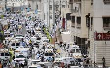 Saudi ambulances arrive with hajj pilgrims who were injured in a stampede at an emergency hospital in Mina on September 24, 2015. At least 717 people were killed and over 800 injured. Picture: AFP