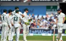 England's Jonny Bairstow (R) stands by as Australia's captain Tim Paine (2nd R) has a word on the fourth day of the third Ashes cricket Test match between England and Australia at Headingley in Leeds, northern England, on 25 August 2019. Picture: AFP